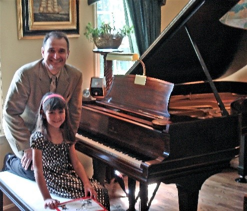 Professor Jelasic with one of his young students following her piano recital